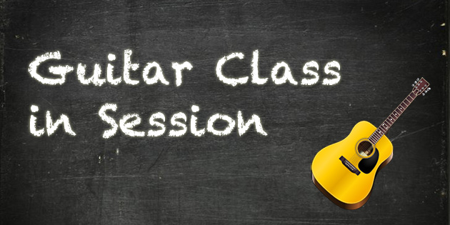 guitar class in session on chalkboard