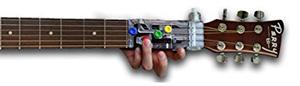 Chordbuddy on a guitar